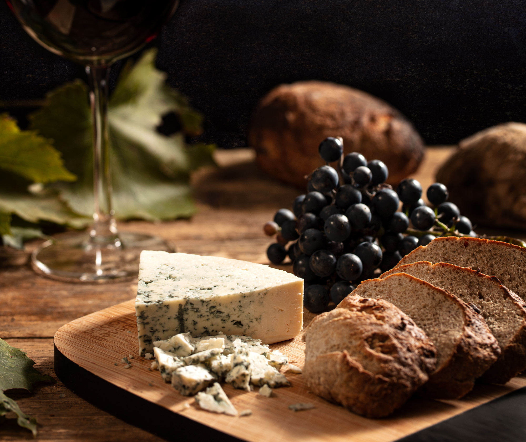 Food photography moody wine and cheese Swiss Hotel Photographer Adrian Kilchherr